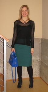 Wearing the Helmut Lang top with YSL handbag