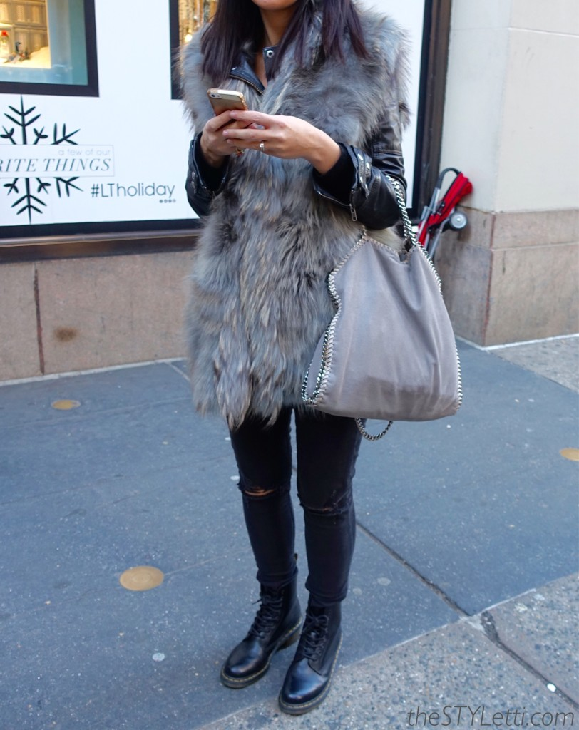 Fur vest with leather sleeves underneath