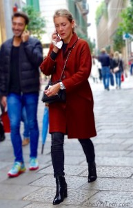 Oxblood statement coat seen in Milan
