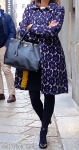 Purple statement coat in Milan