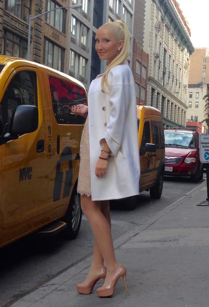 Liliya Anisimova's white Ted Baker coat