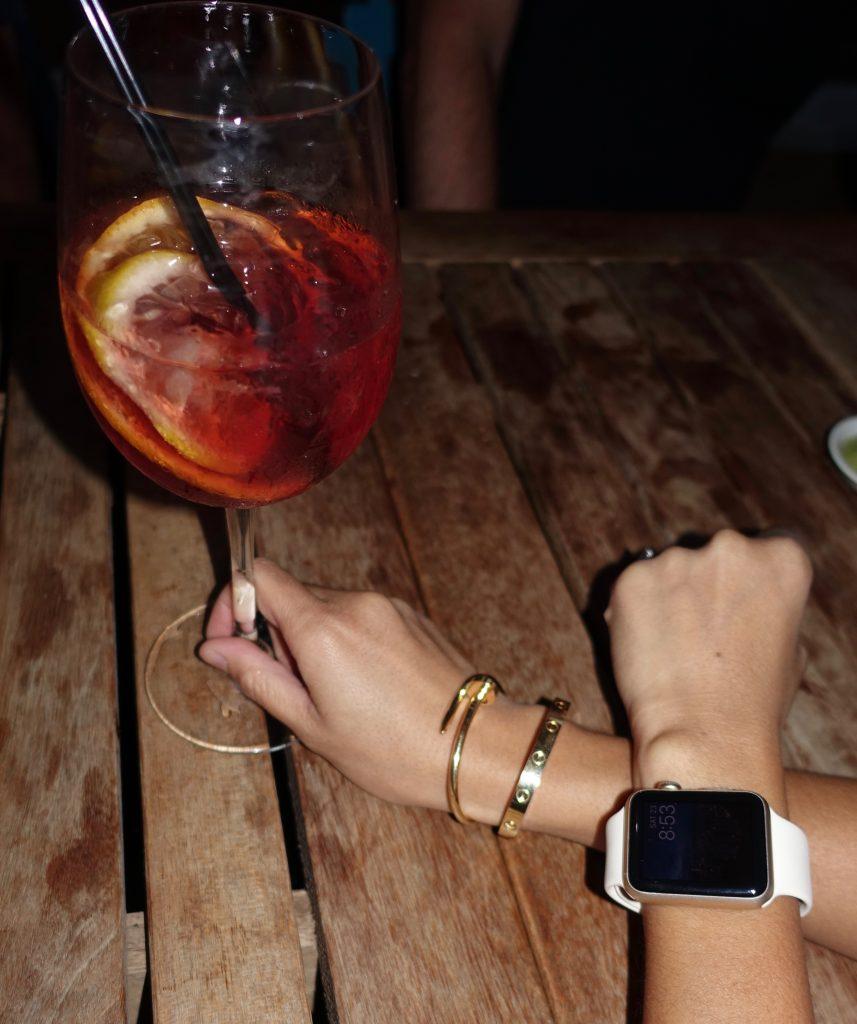 Accessories: Cartier bracelets, Apple watch and sangria