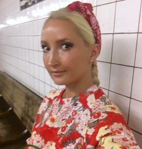 Liliya's red & green outfit in the subway