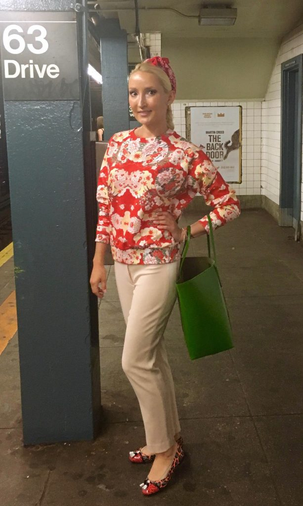 Liliya's red/green outfit in the New York subway