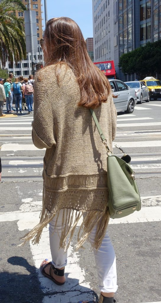Styling a long cardigan with fringe