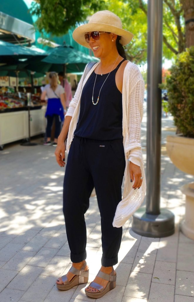 White long cardigan over black pants and top