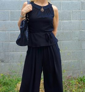 Close up of outfit with vintage jewelry