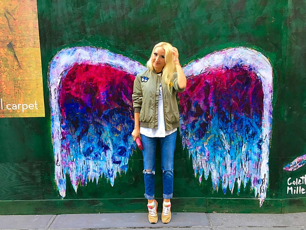 Liliya in front of the wings graffiti