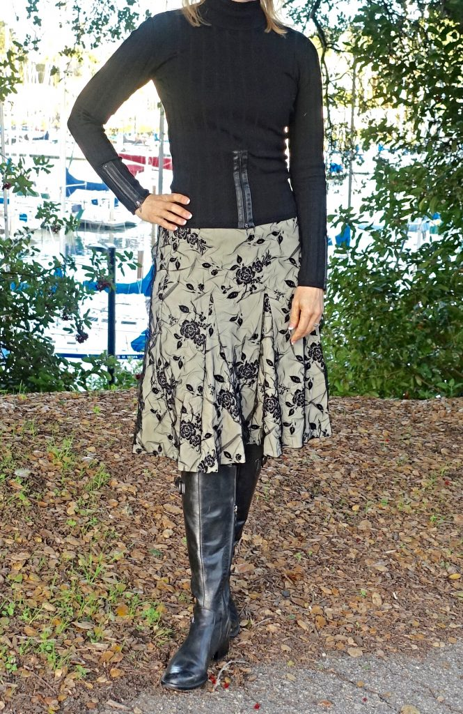 Styling riding boots with an A-line pleated skirt