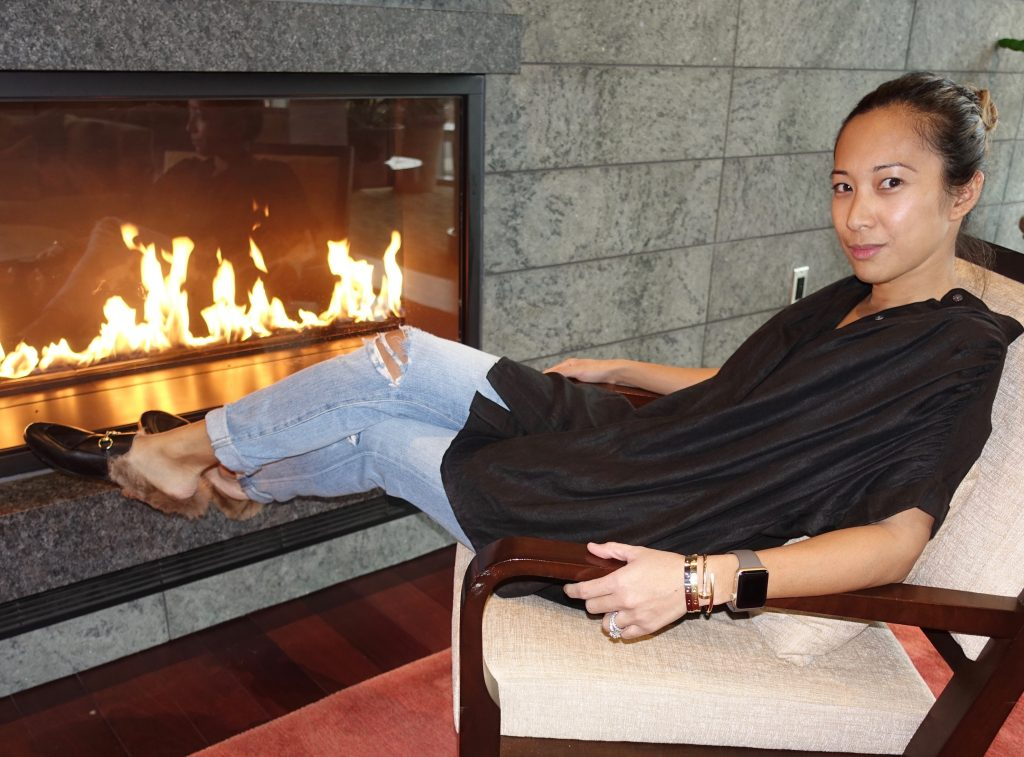 Christina reclining in her cozy shearling mules outfit