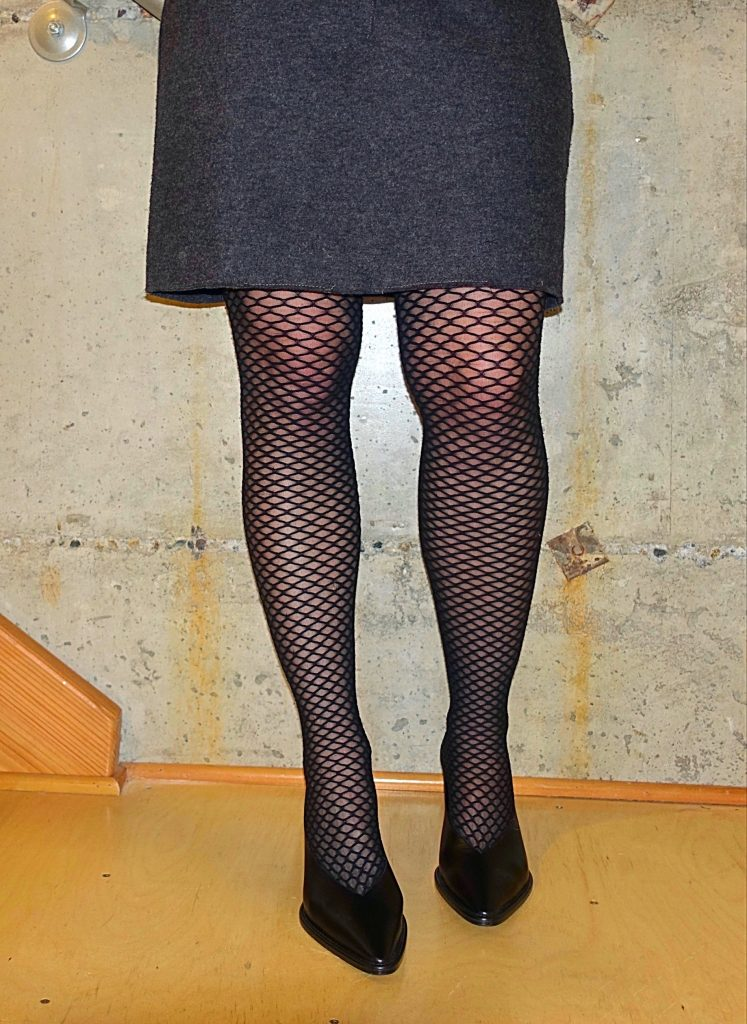 Lower half of outfit with fishnets for work