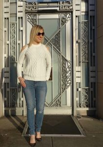Cold shoulder sweater with distressed jeans