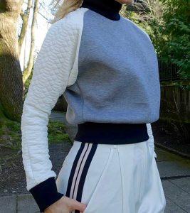 Close up of Layana Aguilar sweatshirt, Rachel Zoe pants