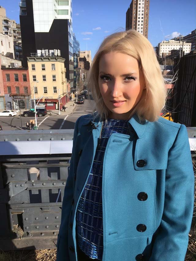 Liliya in her blue outfit, up close