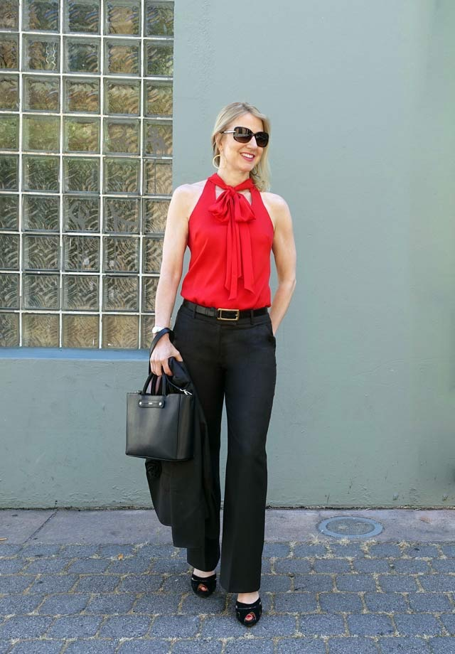 Pussy bow sleeveless top with pant suit