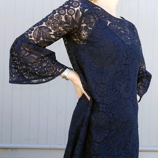 Bell-sleeved lace top