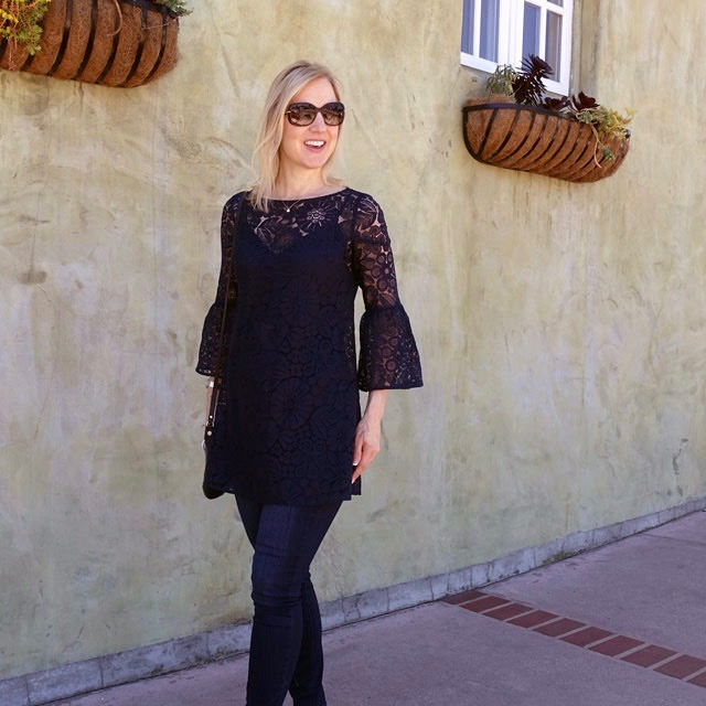Bell-sleeved lace top with skinny jeans