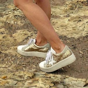 Gold sneakers with stars