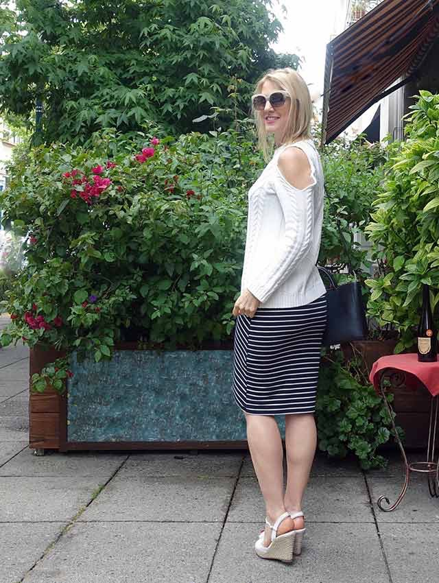 Cold-shoulder sweater and striped skirt