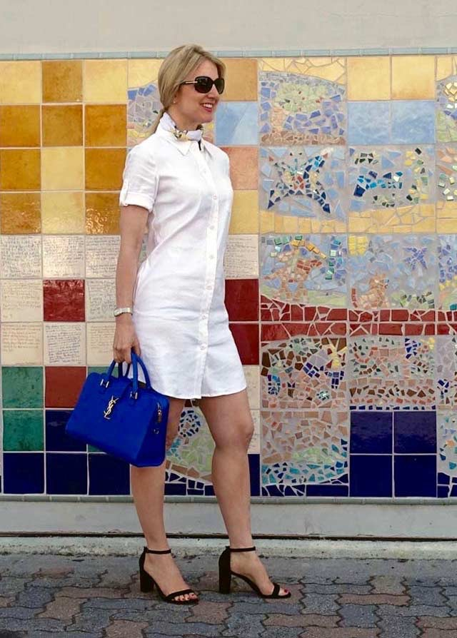 White shirt dress and blue handbag