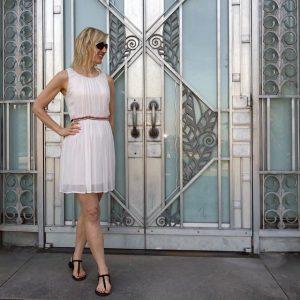 Ancient Roman-inspired dress against Art Deco building