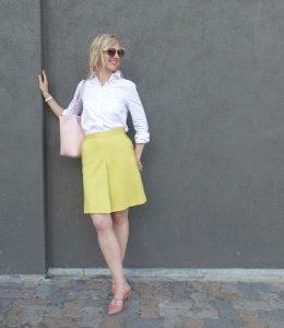 Primrose yellow skirt, pink accessories