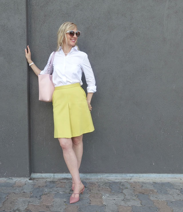 Primrose yellow skirt, pink accessories