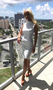 Minika Ko white dress with salmon shoes
