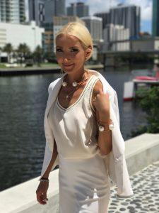 Minika Ko suit with Chanelesque jewelry