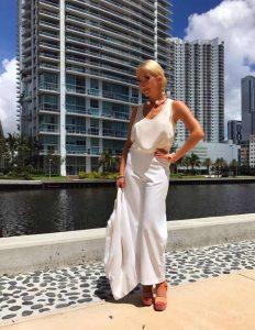 Minika Ko white stain-resistant suit